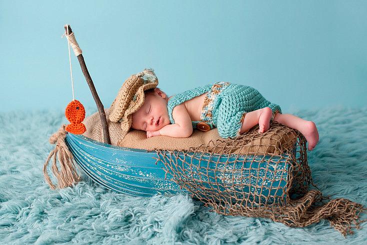 bigstock-Newborn-Baby-Boy-In-Fisherman--109427246