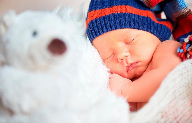 bigstock-Newborn-Baby-In-Knit-Cap-And-T-115389614