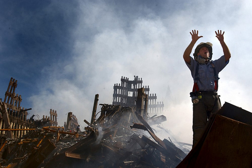 010915-N-3995K-015 New York, N.Y. (Sept. 15, 2001) -- A New York City fireman calls for 10 more rescue workers to make their way into the rubble of the World Trade Center.  U.S. Navy Photo by Journalist 1st Class Preston Keres.  (RELEASED)