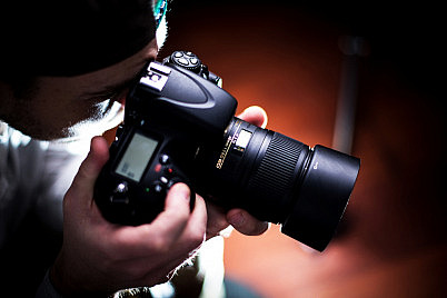 The Photographer. Paparazzi Photographer with DSLR Camera - Closeup. Photography Business Theme. People Photo Collection. ** Note: Slight blurriness, best at smaller sizes